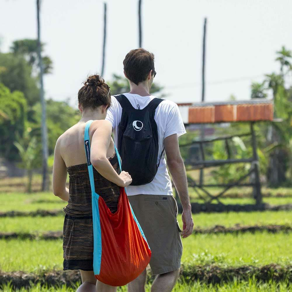 Man Wearing Eco Backpack in Rice Field