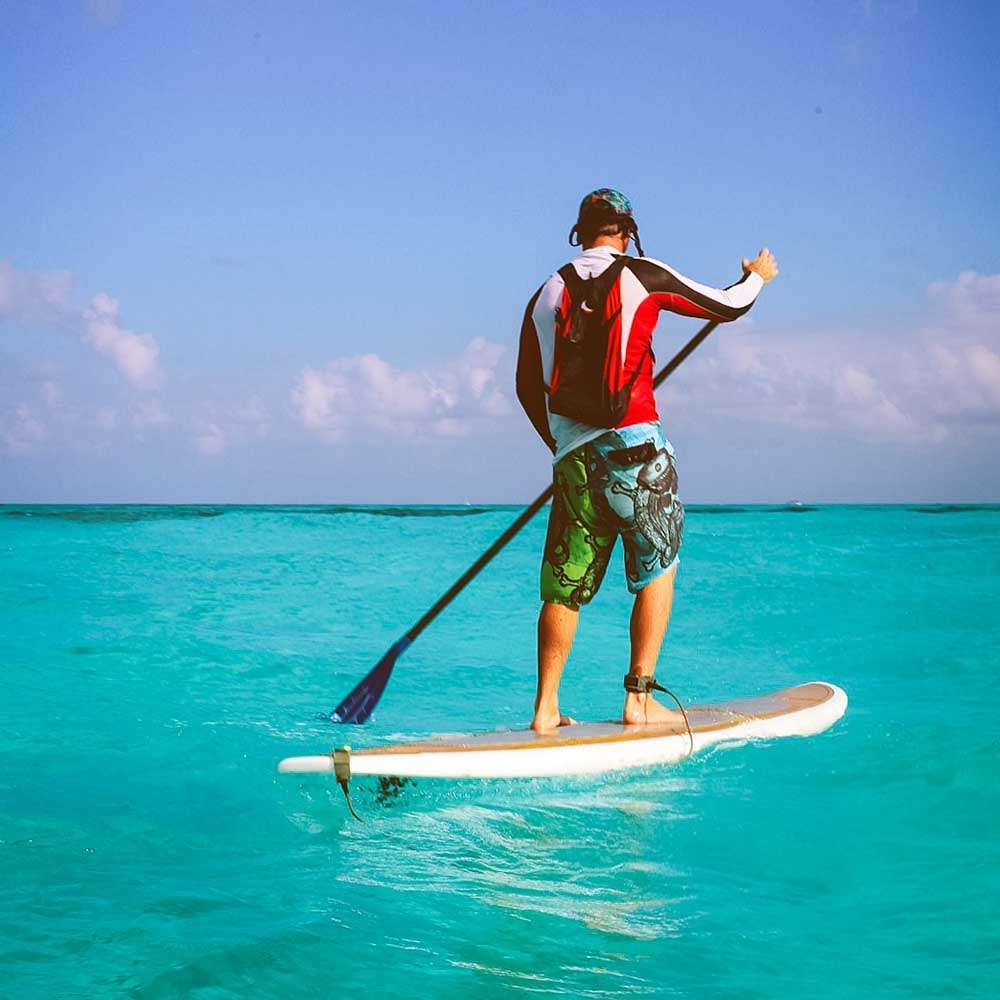 Man Wearing Eco Backpack On Paddle Board